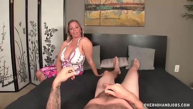Busty milf jerks off her step-son