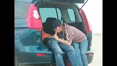 Mom gives son blowjob in the back of the car